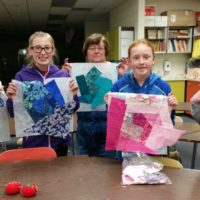 Youth Quilting Classs holding quilt blocks